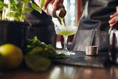 Classic modern basil smash cocktail Stock Photo
