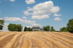 Classic Modern Farm House Overlooking Field Royalty Free Stock Images