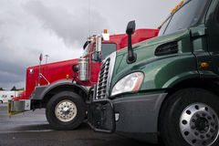Classic and modern red and green semi trucks Stock Photo