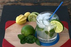 Classic Mojito. Mojito with mint, lime and straw Royalty Free Stock Photos