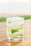 Classic mojito cocktail by a pool outdoors Stock Photo