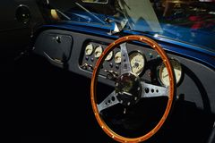 Classic Morgan automobile dashboard. The elegant dashboard of a Morgan car is technological simplicity Stock Image
