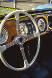 Classic Morgan retro car steering wheel and wooden board Stock Image