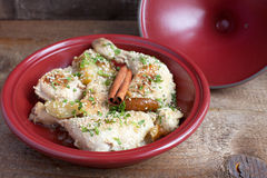 Classic Moroccan chicken tagine with caramelized pears, cinnamon Stock Image