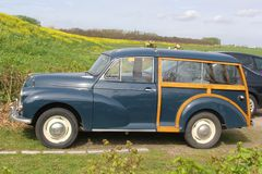 Classic Morris Minor 1000 oldtimer in Dutch polder. Classic Morris Minor 1000 Traveller oldtimer in the Eempolder in the Netherlands Stock Photos