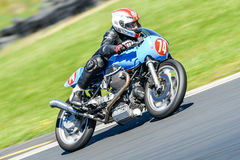 Classic Moto Guzzi motorcycle on a race track Royalty Free Stock Photo