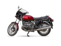 Classic motorcycle. Old-fashioned motorcycle isolated on white Royalty Free Stock Photography