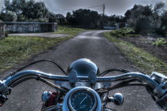 Classic motorcycle on a country road. In hdr tone mapping Stock Images