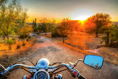 Classic motorcycle on the edge of the road. At sunset Stock Images