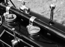 Classic motorcycle instruments. Early vintage motorcycle instruments and levers on gas tank Royalty Free Stock Photo