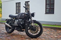 Classic Motorcycle Parked In Front Of A House Royalty Free Stock Photography