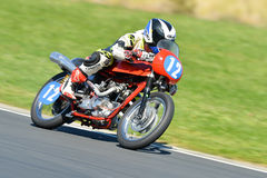 Classic motorcycle on a race track Stock Image