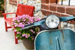 Classic motorcycle with red bench Royalty Free Stock Images