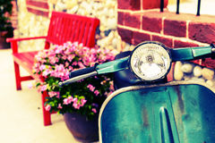 Classic motorcycle with red bench Royalty Free Stock Photos