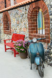 Classic motorcycle with red bench Royalty Free Stock Image