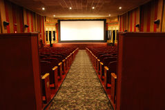 Classic movie theater. Classic one screen movie theater with one large screen and many seats stock image