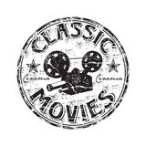 Classic movies rubber stamp. Black grunge rubber stamp with movie projector shape and the text classic movies written inside the stamp Royalty Free Stock Photography