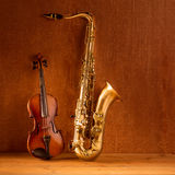 Classic music Sax tenor saxophone violin in vintage stock photography