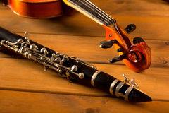 Classic music violin and clarinet in vintage wood stock image