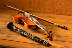 Classic music violin and clarinet in vintage wood Stock Photos