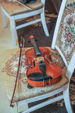 Classic music violin vintage, close up. Violin on chair Royalty Free Stock Photos