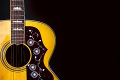 Musical instrument wood acoustic six-string guitar isolated on blackbackground royalty free stock photography
