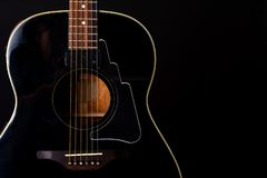 Musical instrument wood acoustic six-string guitar isolated on blackbackground stock photos