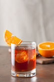 Classic negroni cocktail on wooden table royalty free stock images
