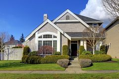 Classic new American house exterior in the spring. Classic new beige American house exterior in the spring royalty free stock image