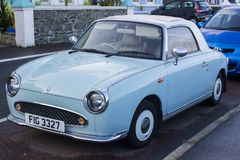 A Classis Nissan Figaro automatic convertible car with mint chrome trim royalty free stock images