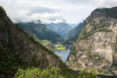 Classic Norwegian view with mountains, trees and fjord, Norway Royalty Free Stock Photos