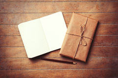 Classic notebook and pencil with parcel Stock Photography