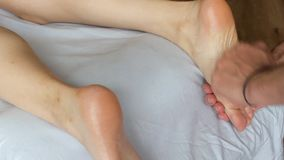 Classic oil massage of a girl`s leg closeup. A classic oil massage of a girl`s leg closeup stock video
