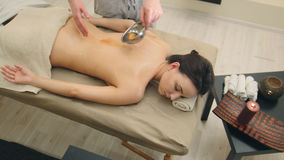Classic oil massage in the spa salon - relaxation therapy for attractive young woman Stock Image