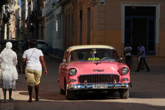 Classic old American car in the streets of Havana. HAVANA, CUBA, FEBRUARY 15, 2014 : Classic old American car in the streets of Havana. Classic cars are still in Royalty Free Stock Photos