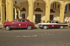 Classic old American cars parked in front of hotel in Old Havana, Cuba Stock Image