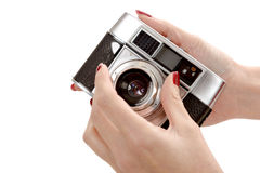 Classic old analog camera on white Royalty Free Stock Images