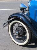 Classic old blue car, detail of the wheel and mudguard. Old blue classic car, wheel detail and mudguards and chrome in sunny day Stock Photo
