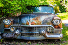 Classic Old Cadillac. DETROIT, MICHIGAN - May 11, 2015: Wreck of a vintage Cadillac. The logo has changed, but this original was based on coat of arms for Le Stock Image