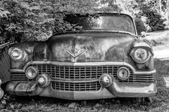 Classic Old Cadillac. DETROIT, MICHIGAN - May 11, 2015: Wreck of a vintage Cadillac. The logo has changed, but this original was based on coat of arms for Le Royalty Free Stock Image