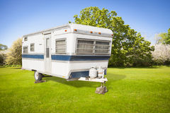 Classic Old Camper Trailer In Grass Field Stock Images