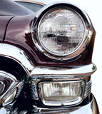 Classic old car. Closeup front right view on white background Stock Photography