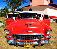 A classic old car is red color Stock Images