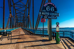 Classic Old Chain of Rocks Bridge crosses the Missouri River in St. Louis and shows classic neon signs of Route 66 Auto Court Royalty Free Stock Image