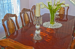 Classic Old Fashioned Dining Table in Home Environment Royalty Free Stock Photos