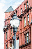 Classic Old Lamp Post by Brick Building Royalty Free Stock Photos