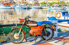 Classic old motor in small Greek port, Greece Royalty Free Stock Photo