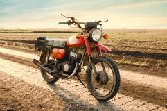 Classic old motorcycle. Classic old motorcycle on a dirt road Stock Images