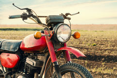 Classic old motorcycle. Classic old motorcycle on a dirt road Royalty Free Stock Image