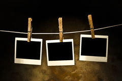 Classic old polaroid photo Held By Clothespins Royalty Free Stock Photo